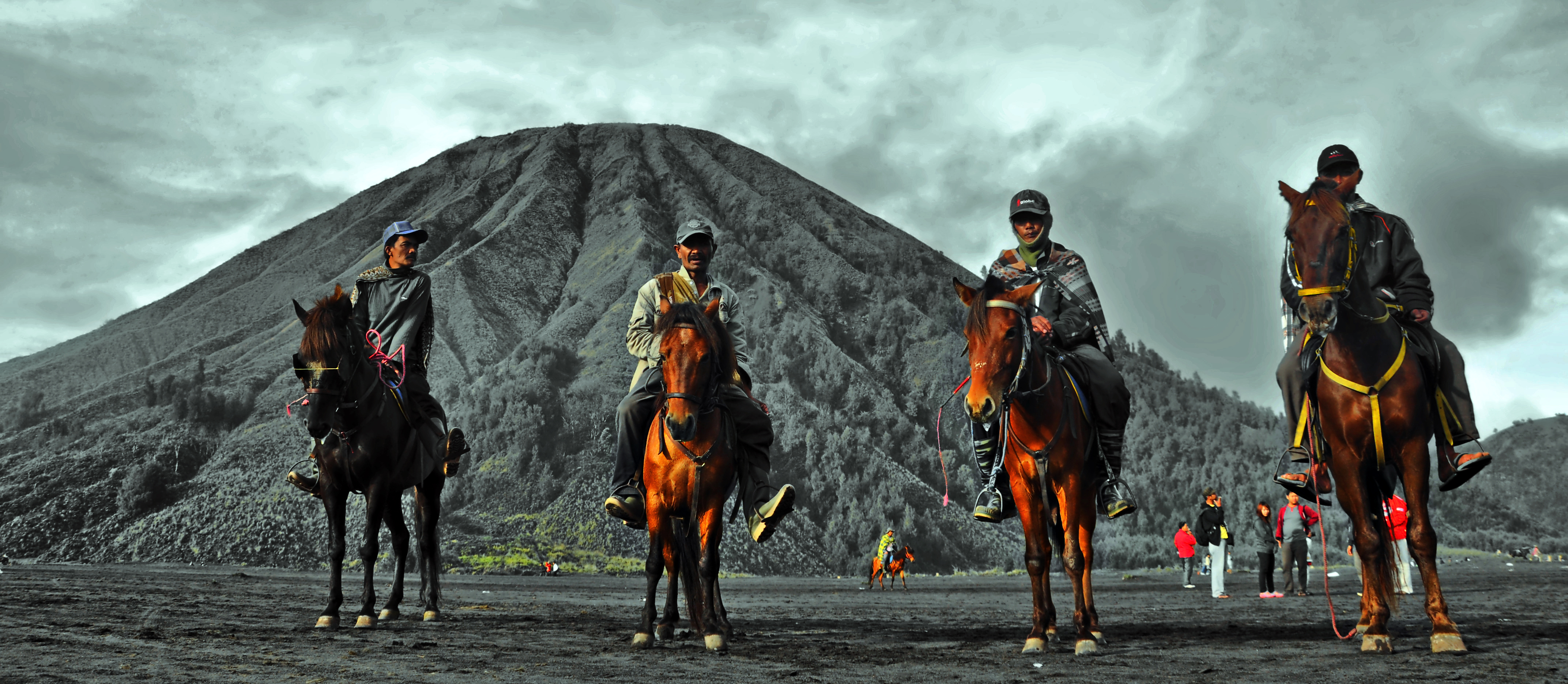 Horse riders at Mount Bromo, East Java, posing in front of Mount Batok