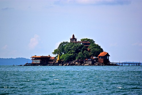 A cool looking island with what appears to be a Wat on our way to Koh Rong Samloem