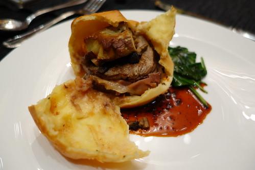 Filet Mignon En Brioche Dissected to Reveal Beef Tenderloin with Foie Gras & Prosciutto Ham within the Brioche.