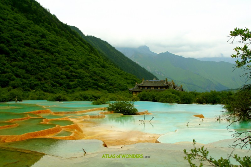 ... famous natural features in China is the scenic valley of Huanglong