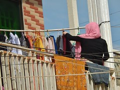 Muslim Lady Hanging Out the Washing