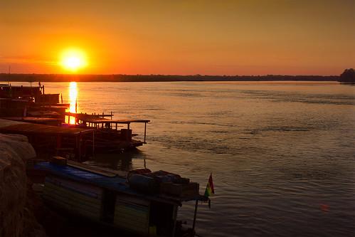 sunset river boats amazon tropical amazonia madrededios riberalta