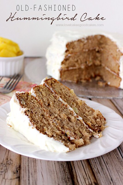 Old-Fashioned Hummingbird Cake on a white plate with a fork.
