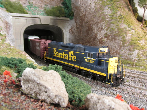 An Atchison, Topeka & Santa Fe Railroad freight train from the 1960's and early 1970's era exits the tunnel.  The Oak Park Society of Model Engineers,H.O Scale Model Railroad Club.  Oak Park Illinois.  July 2013. by Eddie from Chicago