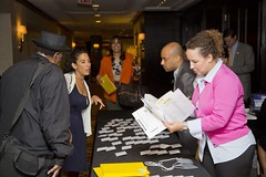 Staff assisting guest with registration.