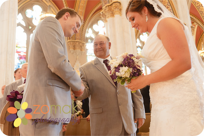 Father of the bride gives his daughter to her groom at the st helena cathedral in helena montana