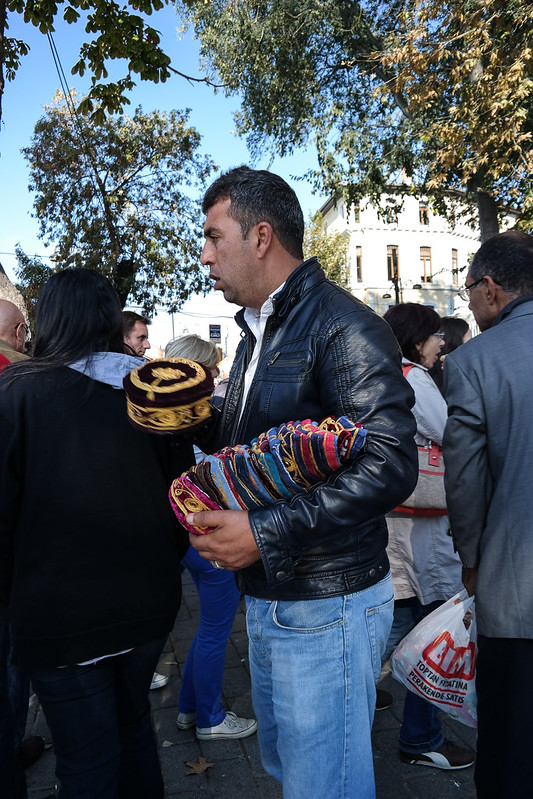 Street Vendor Selling Hats
