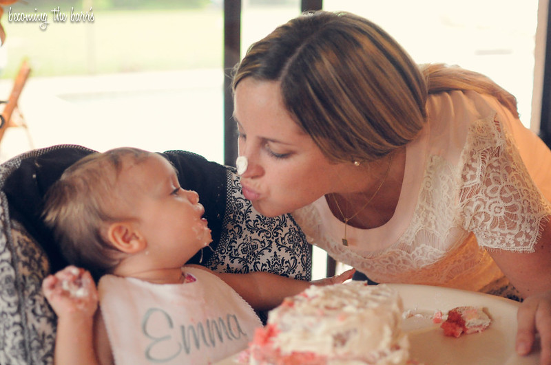 baby and mommy eating cake at first birthday party