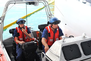 Petty Officer 1st Class Andrew Bowe and Petty Officer 2nd Class Hali Lombardi perform boat checks as part of a training drill aboard the Coast Guard Cutter Charles Sexton in Key West, Fla., Jan. 28, 2014. Bowe, an honorary Conch of Key West, and Lombardi, a Key West Conch, returned to their hometown to serve aboard the newest Coast Guard cutter in the fleet. (U.S. Coast Guard Photo by Petty Officer 2nd Class Sabrina Laberdesque)