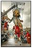 LILLIPUTIANS WORKING THE GIANT PUPPET by Derek Hyamson
