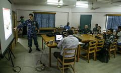Lt. Cmdr. Toby Wayne Palmer, an entomologist assigned to the hospital ship USNS Mercy (T-AH 19), gives a presentation on dengue transmission during a Pacific Partnership dengue symposium.
