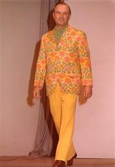 gown(0.0), maroon(0.0), sari(0.0), dress(0.0), orange(1.0), pattern(1.0), clothing(1.0), yellow(1.0), peach(1.0), formal wear(1.0), fashion design(1.0),