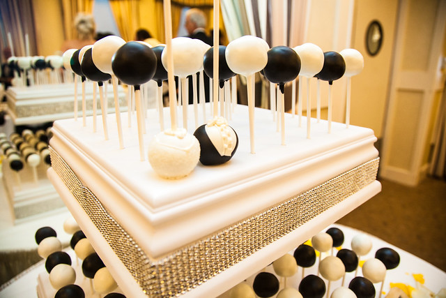 Close-up of a white cake pop stand decked out in glammy rhinestones!