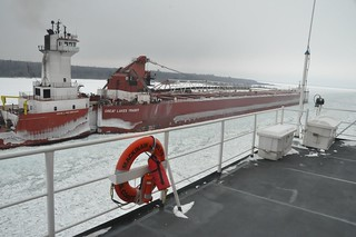 Coast Guard Cutter Mackinaw, home-ported in Cheboygan, Mich., passes port-to-port with the tug Joyce L. VanEnkevort and its barge the Great Lakes Trader in the Stribling Dike on the St. Mary's River Jan. 10, 2014. The crew of the Mackinaw was conducting ice-breaking operations, including leading a five-ship convoy up the lower part of the river. (U.S. Coast Guard photo by Lt. David Lieberman)