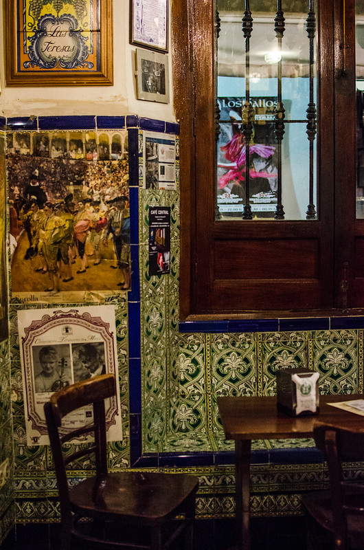 Tile work and small tables populate the colorful, traditional interior of Las Teresas in Sevilla, Spain.