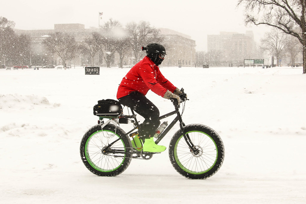 snow cyclist on Madison Av
