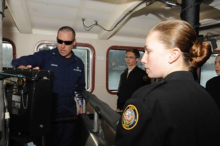 Petty Officer 2nd Class Michael S. Sheahan, a boatswain's mate assigned to Coast Guard Cutter Sea Devil, an 87-foot patrol boat attached to Coast Guard Maritime Force Protection Unit Bangor, Wash., explains how to operate the cutter's on board weapons system to a group of Navy Junior Reserve Officers Training Corps cadets from Bremerton High School in Bremerton, Wash., while underway in Puget Sound, March 24, 2014. The Sea Devil and its sister ship, Coast Guard Cutter Sea Fox, were established to assist the Navy in providing security for U.S. Navy Nuclear Ballistic Missile Submarines transiting in the vicinity of their homeport of Bangor, Wash. U.S. Coast Guard photo by Petty Officer 3rd Class Katelyn Shearer.