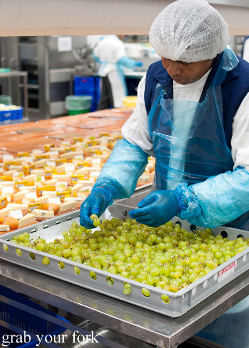 Selecting grapes for cheeseboards during a behind-the-scenes tour of Emirates Flight Catering