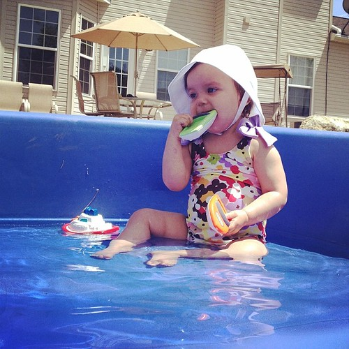 Pool day! Jameson's at the kiddie pool while this teething lady hangs poolside at home