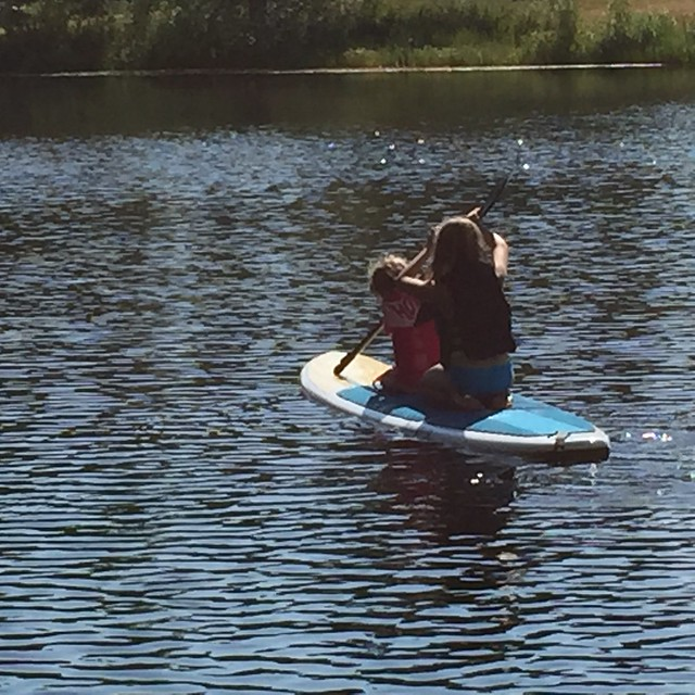 jane and cora on the paddle board
