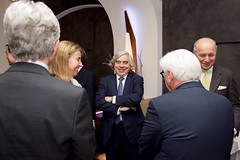 U.S. Energy Secretary Dr. Ernest Moniz chats with European Union High Representative for Foreign Affairs Federica Mogherini, German Foreign Minister Frank-Walter Steinmeier, back to camera, and French Foreign Minister Laurent Fabius on June 28, 2015, in Vienna, Austria, before a working lunch amid their negotiations with Iranian leaders about the future of their nuclear program. [State Department Photo/Public Domain]