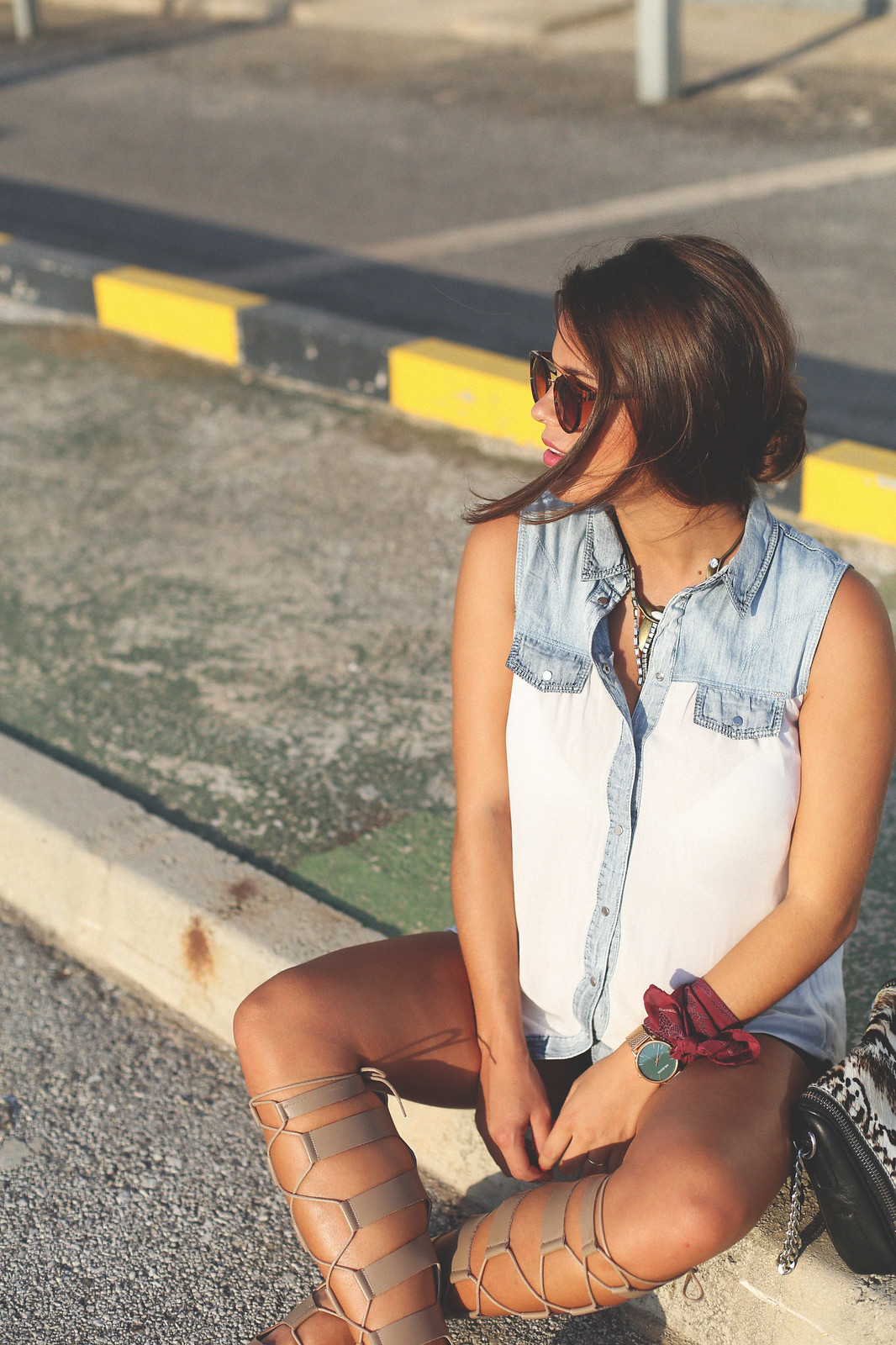 12. white denim vest black shorts sandals