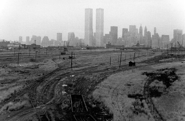 Empty railroads, tumbleweeds, shacks and telephone poles to the horizon like crosses in Jerusalem. Lower Manhattan and the World Trade Center hover in the background over this scene of utter abandonment. Jersey City. March 1975