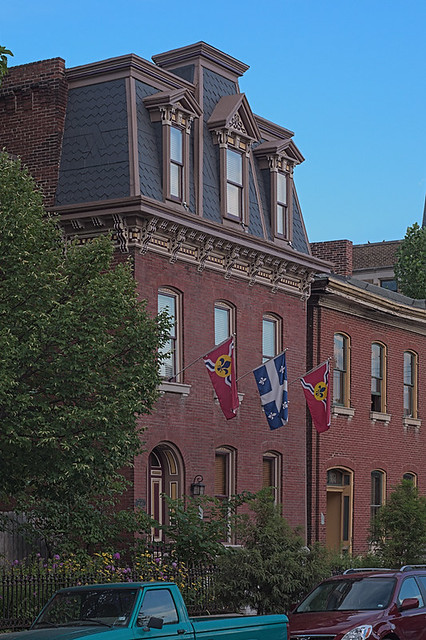 Soulard Neighborhood, in Saint Louis, Missouri, USA - townhouse with Mansard and flags