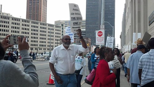 Abayomi Azikiwe, editor of the Pan-African News Wire, outside the federal courthouse in Detroit during the second session of the bank-imposed bankruptcy on the nation's largest African American municipality. This hearing took place on August 2, 2013. by Pan-African News Wire File Photos