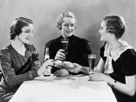 three-women-having-beer-and-sandwiches-b-w