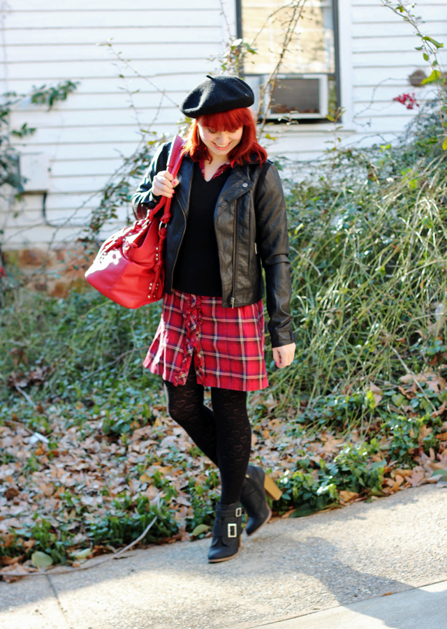 Black Sweater over a Red Plaid Dress, Leather Jacket, Black Beret, Red Camera Bag, & Ankle Boots