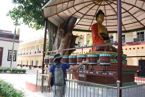 spinning the prayer wheels in a Tibetan monastery