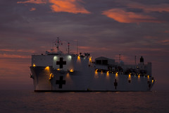 USNS Mercy (T-AH 19) sits at anchorage off the coast of Papua New Guinea during the ship's most recent mission stop for Pacific Partnership 2015. (U.S. Air Force/Senior Airman Peter Reft)