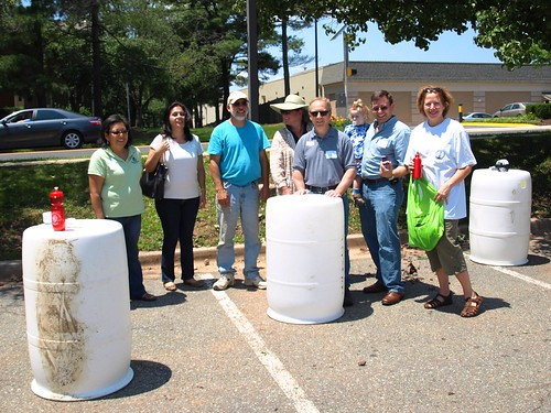 Image of a group of people with rain barrels