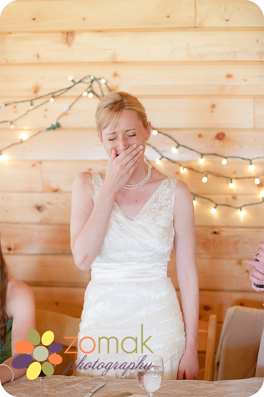 The bride reacts during a speech at her wedding reception at double arrow resort in Seeley Lake Montana.