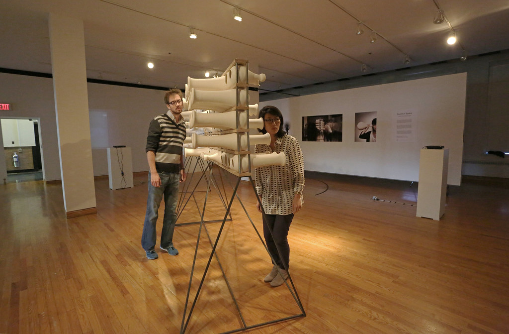 Cocreators James Blair (M.Arch. '13) and Mia Kang (M.Arch. '13) engage the interactive wall.