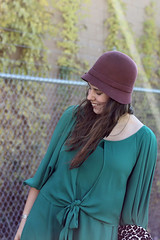 """Roaring 20s Outfit: Brown tights, Frye """"Melissa"""" brown lace-up riding boots, green Anthropologie dress, Burgundy wool cloche hat, leopard brocade swing coat"""