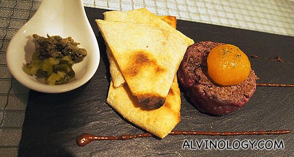 Skyve Beef Tatare – Truffle egg yolk, cilantro, flat bread, ancho chilli aioli, thyme sea salt (S$22)