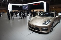sports car(0.0), automobile(1.0), automotive exterior(1.0), exhibition(1.0), wheel(1.0), vehicle(1.0), performance car(1.0), automotive design(1.0), porsche(1.0), porsche panamera(1.0), auto show(1.0), land vehicle(1.0), luxury vehicle(1.0), convertible(1.0), supercar(1.0),