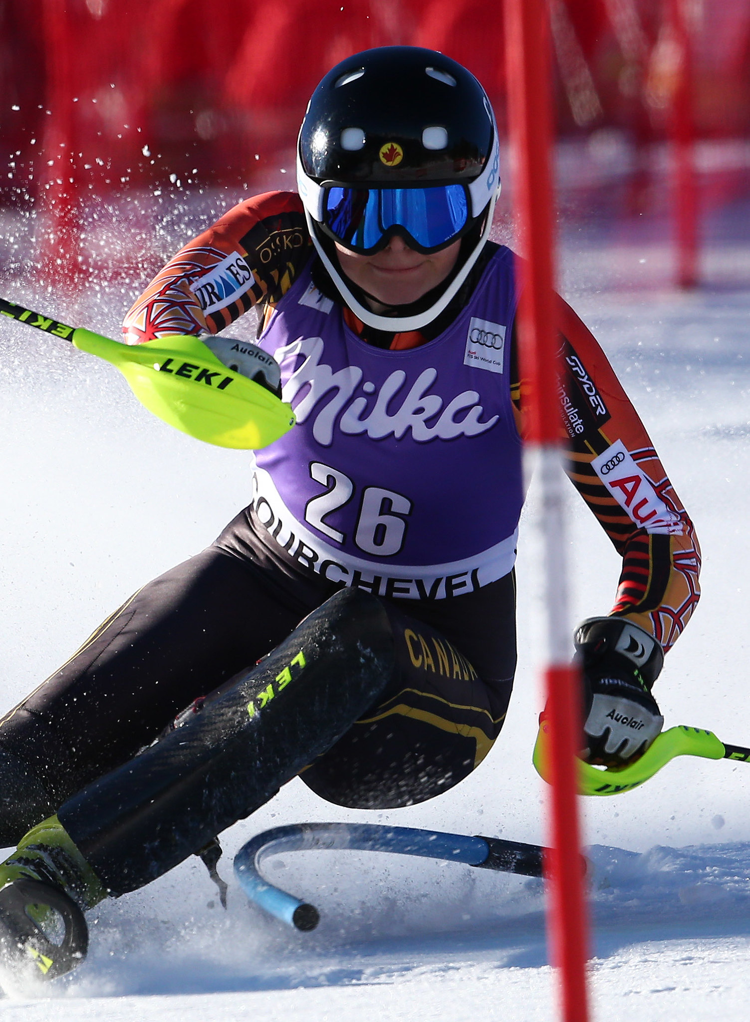 Elli Terwiel hugs a gate during the slalom in Courchevel, FRA