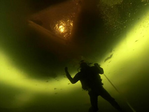 Maine State Police Trooper Elisha Fowlie diving below the ice of Moosehead Lake.