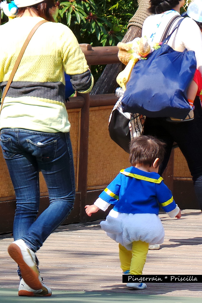 A little kid in Donald Duck costume