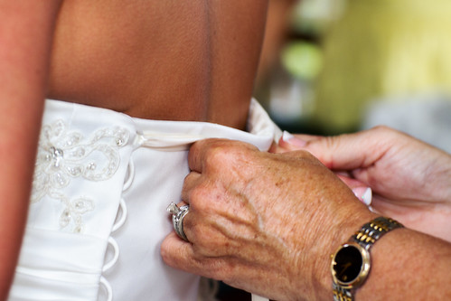 bride buttoning by McBeth