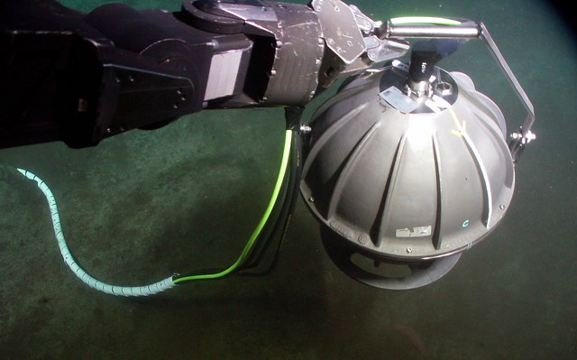 ROPOS carries a replacement broadband seismometer to its installation site at our ODP 1027 location, 6 October 2010. (N47° 45.7685′, W127° 45.4678′; depth: 2659.5m)