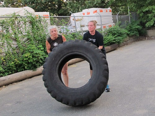 Joan and Theresa, tire flip