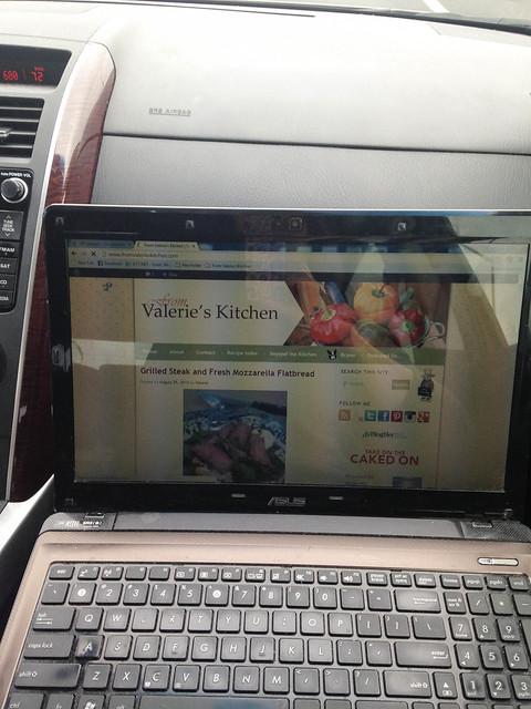 An open laptop computer in a car.