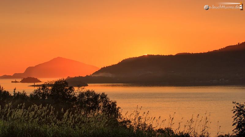 The sun sets behind Gurskøy