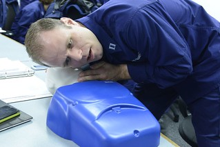 Lt. Joseph Prado, a Enforcement Division member at the 8th Coast Guard District, performs CPR on a training dummy as part of an exercise at Coast Guard Station New Orleans, Dec. 9, 2013. The primary objective of the boat crew college is to enable personnel within the 8th District area of responsibility to get the Coast Guard Boatcrew qualification. (U.S. Coast Guard photo by Petty Officer 3rd Class Carlos Vega.)