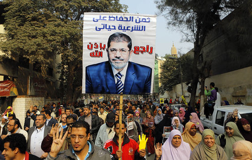 Egyptian clashes between anti-coup protesters and military supporters took place on December 20, 2013. Demonstrations against the draft constitution are escalating. by Pan-African News Wire File Photos