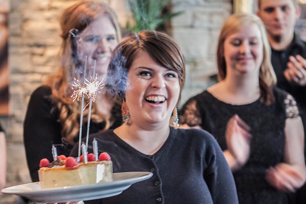 A Lethbridge University Singers tour participant gets a birthday surprise at the Boradwalk restaurant in Cork